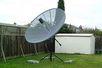 10 foot satellite dish (steerable) used for downlinking TV shows.